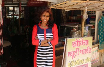 Jharna outside her huble salon named after he daughter